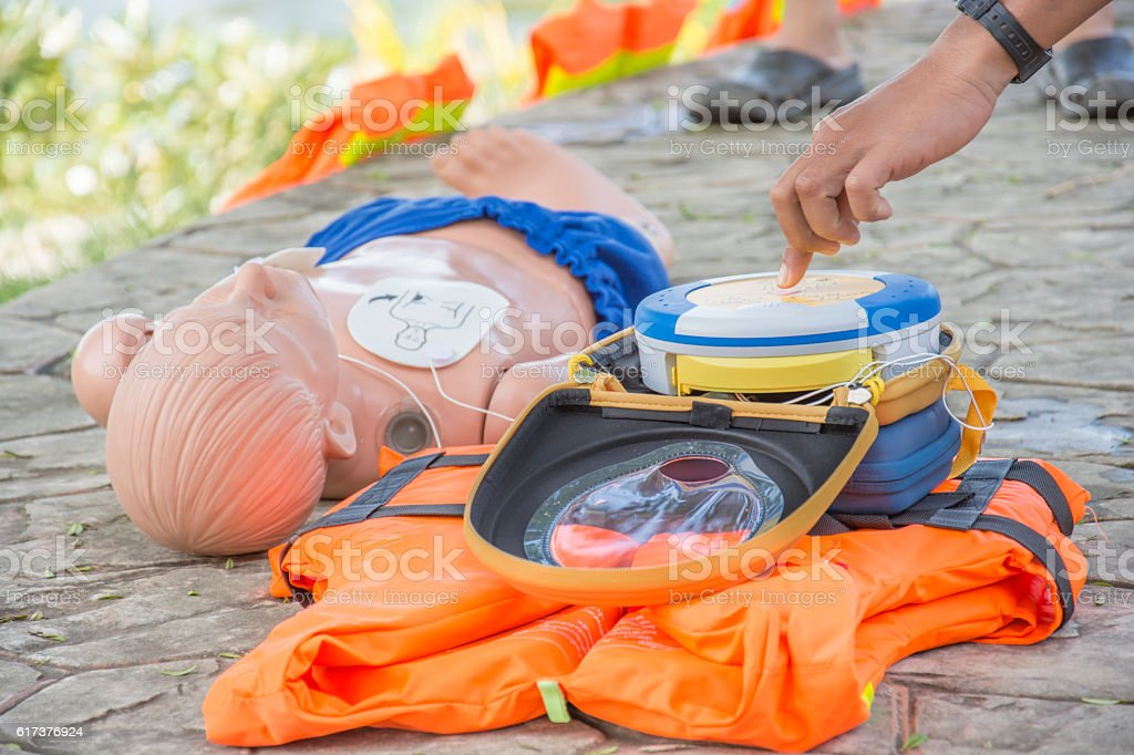 CPR and AED training child dummy drowning case hand puch​​​ foto