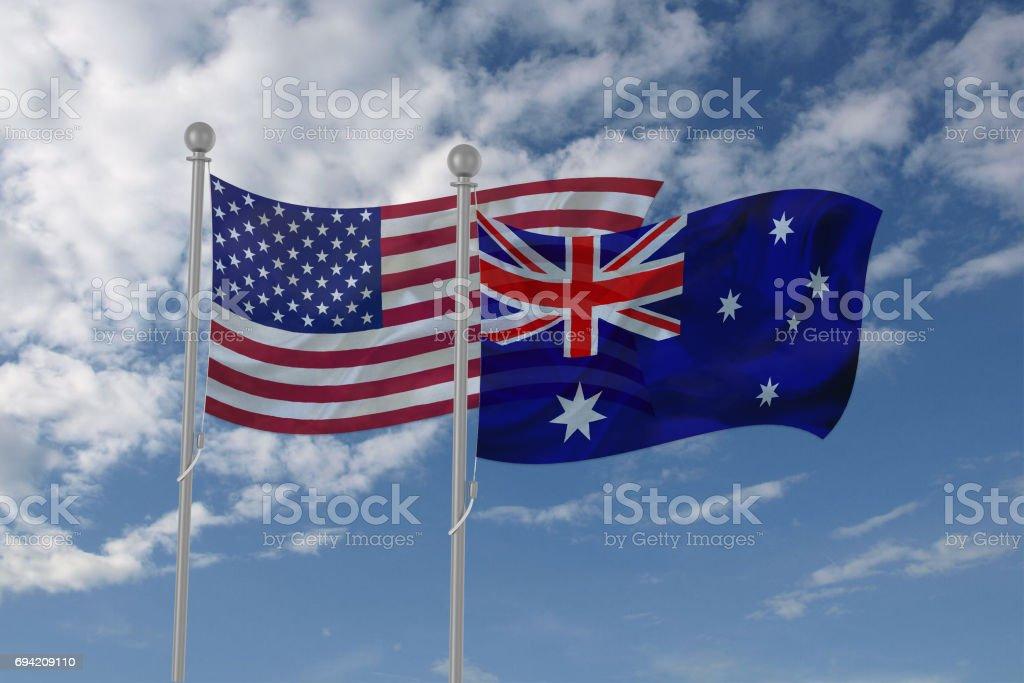 USA and Australia flag waving in the sky stock photo