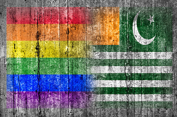 LGBT and Azad Kashmir flag on concrete wall stock photo