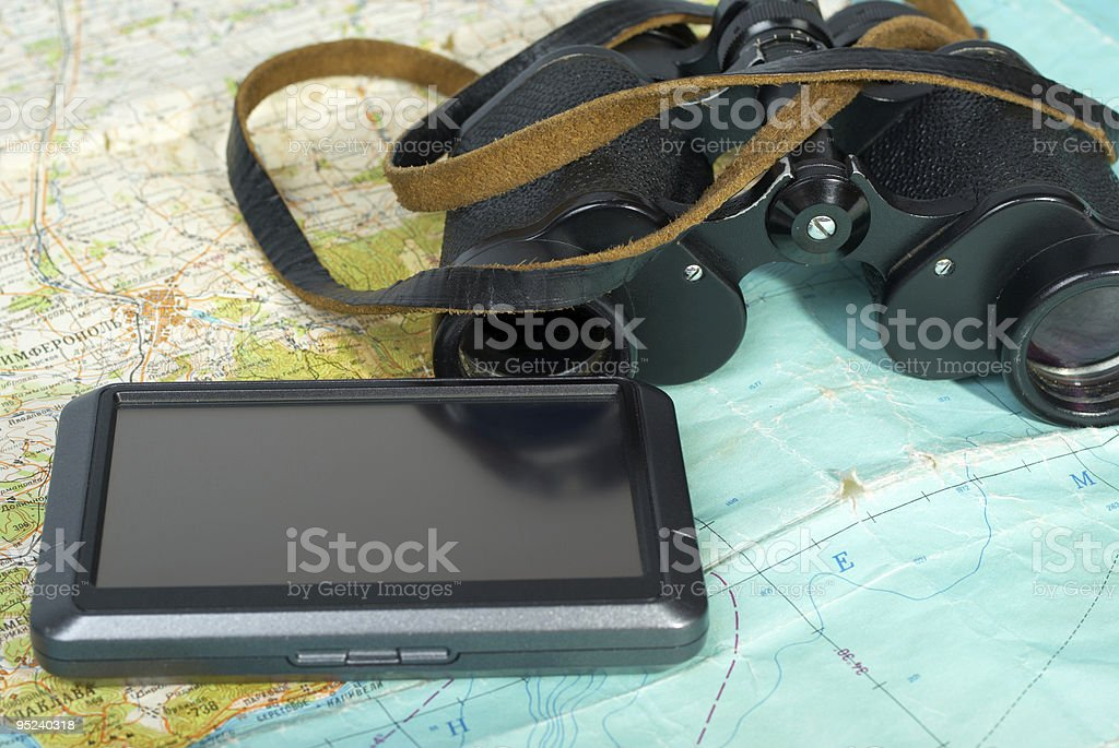 GPS and binoculars on topographical Map royalty-free stock photo