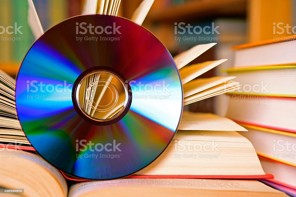 CD and books close-up (digital audiobook concept) stock photo