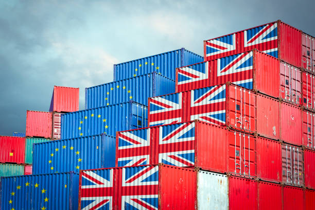 eu and british cargo containers - scambio commerciale foto e immagini stock