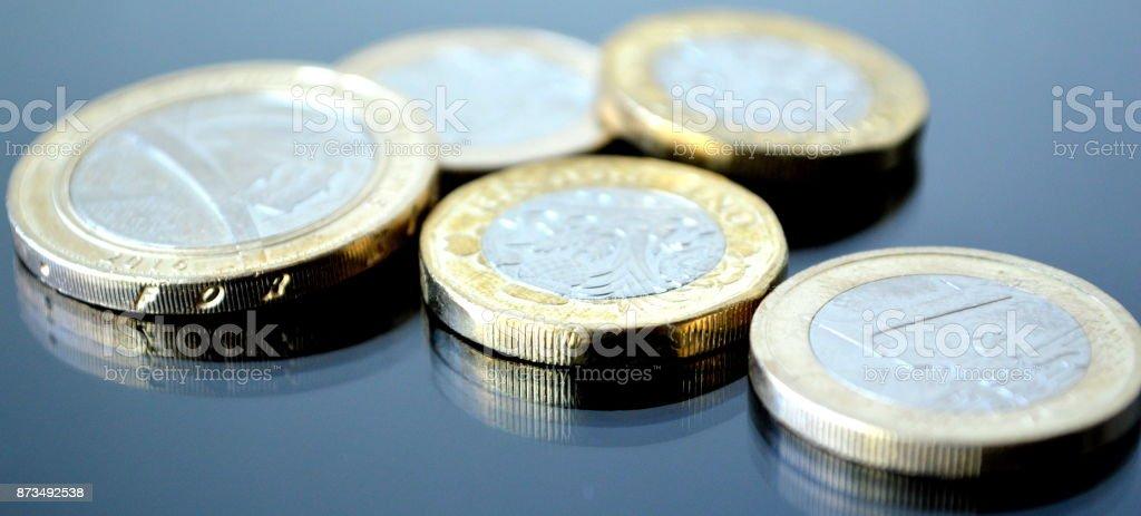EURO and British pund-coins stock photo