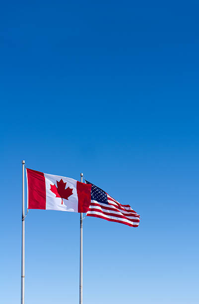 USA and Canada Flags stock photo