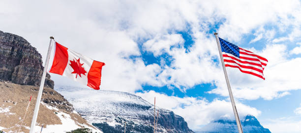 US and Canadian flags in Logan Pass stock photo