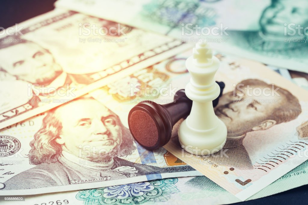 US and China finance tariff trade war concept, black loser and white winner chess king on US dollar and china yuan banknotes, world major market countries, import and export barrier stock photo