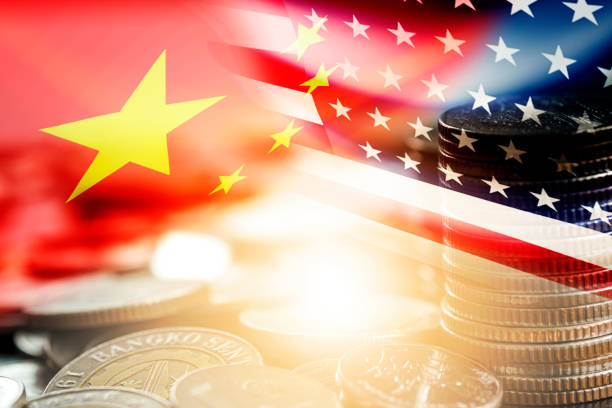 USA and China flag on coins stacking .It is symbol of economic tariffs trade war and tax barrier between United States of America and China. USA and China flag on coins stacking .It is symbol of economic tariffs trade war and tax barrier between United States of America and China. trade war stock pictures, royalty-free photos & images