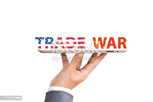 928696036 istock photo USA and China flag print screen to trade war wording with Businessman  who hold up tablet for risk managment during economic tariff trade war between both countries. 1172515365