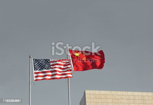 USA and China flags. Trade war economy conflict, tax business finance money / United States vs China.