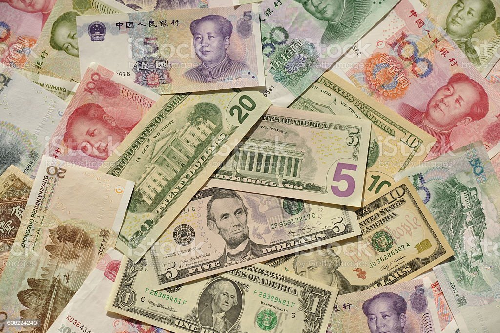 USA and Chinese Banknotes,money, dollars, yuans stock photo
