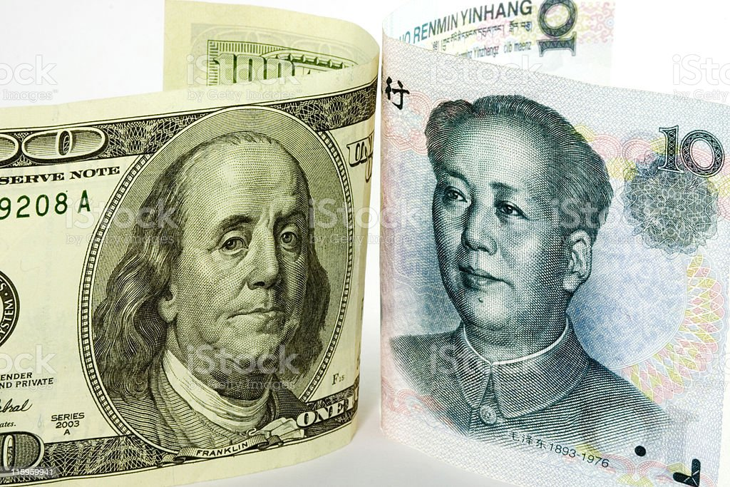 US and Chinese currencies stock photo
