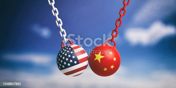 istock USA and Chinese flags wrecking balls swinging on blue cloudy sky background. 3d illustration 1048647832