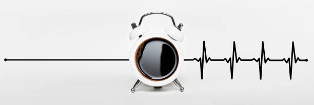 COFFEE and CLOCK with heart rate - Awaking - Wake up / Clock concept (Click for more) stock photo