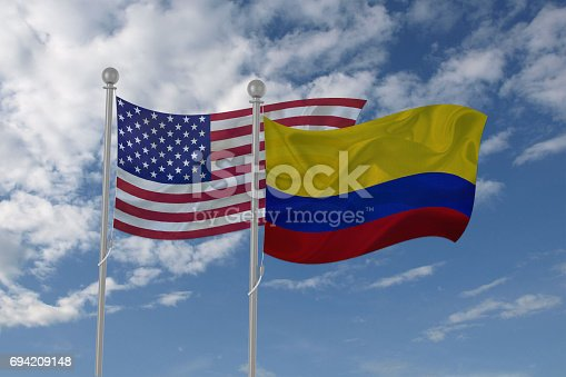 istock USA and Colombia flag waving in the sky 694209148