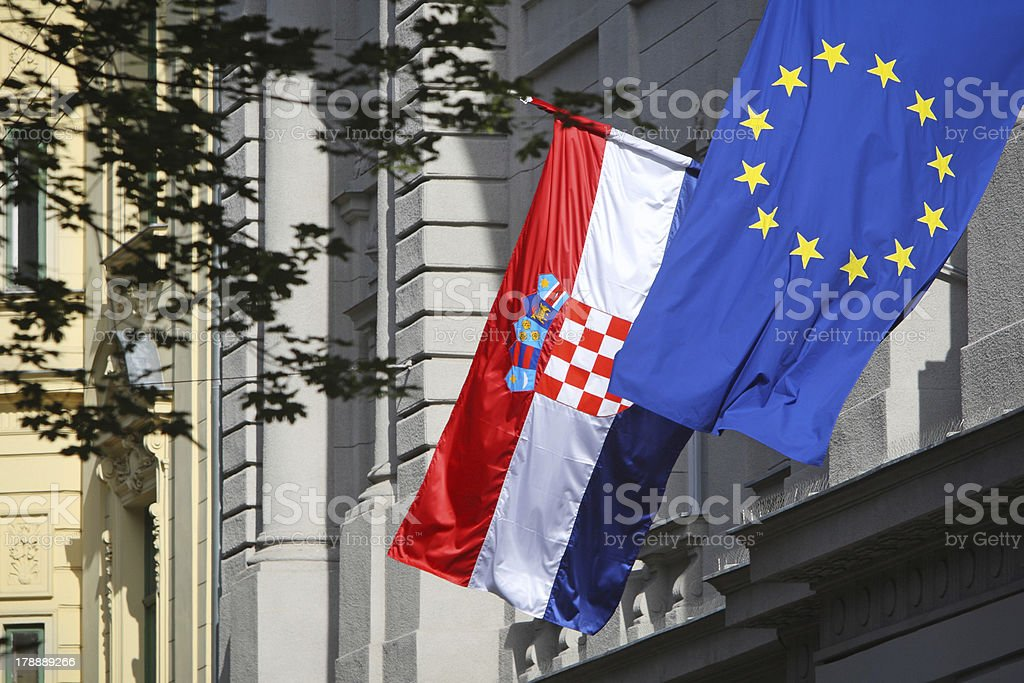 EU and Croatian flag on the building royalty-free stock photo