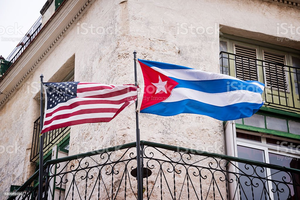 US and Cuban flags side by side in Havana, Cuba stock photo