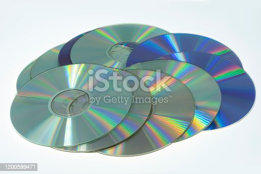 Shot on the old CD and DVD discs on a white background.