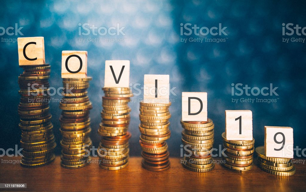 COVID-19 and economy recession Diminishing stacks of coins with COVID-19 (Coronavirus disease) written on them 2020 Stock Photo