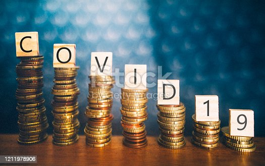 Diminishing stacks of coins with COVID-19 (Coronavirus disease) written on them