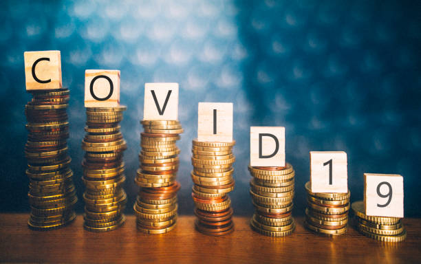 COVID-19 and economy recession Diminishing stacks of coins with COVID-19 (Coronavirus disease) written on them euro symbol stock pictures, royalty-free photos & images