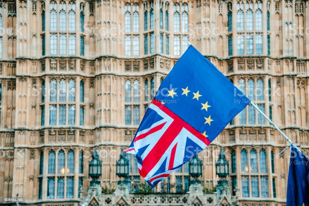 UK and EU flags merged by Houses of Parliament - foto stock