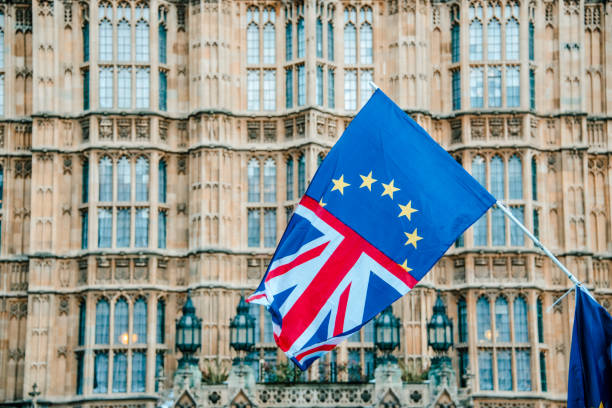 UK and EU flags merged by Houses of Parliament stock photo