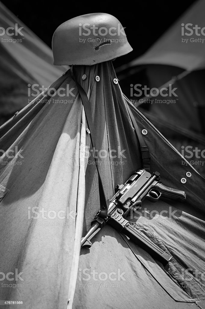 MP 40 and Helmet Hanging on a Tent stock photo