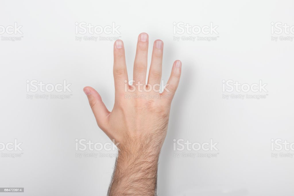 and holding out five fingers isolated on a white background stok fotoğrafı