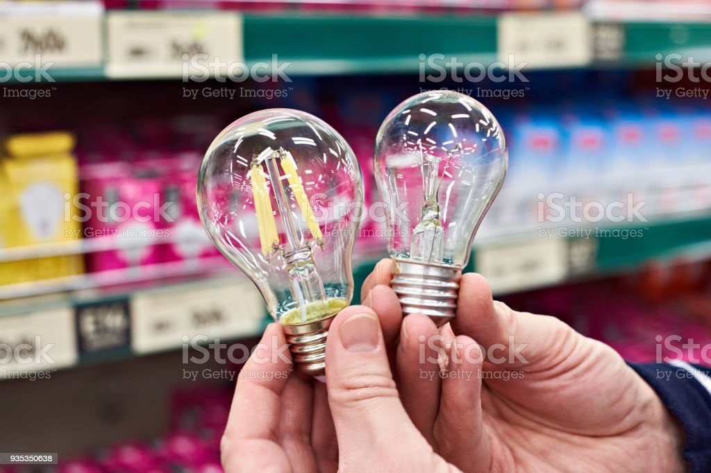 LED and incandescent lamp on store stock photo