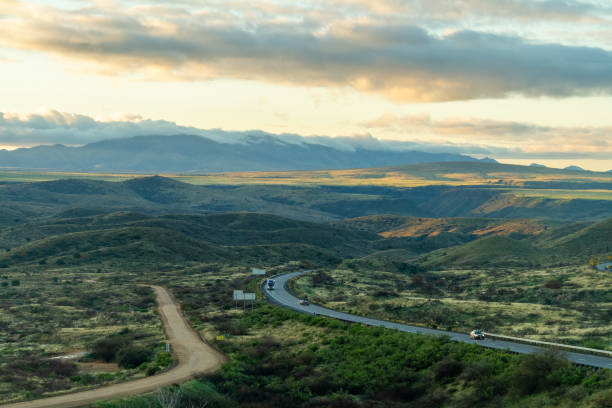 And interstate highway weaving through the wilderness of Arizona in early morning light. stock photo