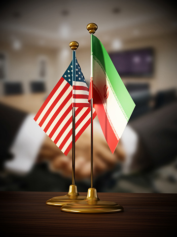 istock USA and Iran desktop flags standing on the table 1005991438