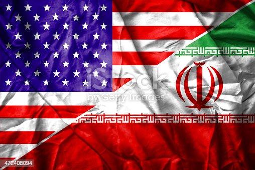 istock USA and Iran flag 472408094