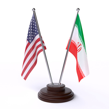 istock USA and Iran, two table flags on white background 1146477623