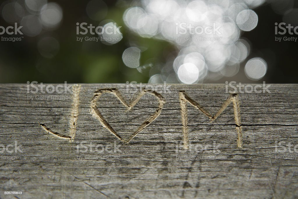 J and M letter - love symbol engraving stock photo