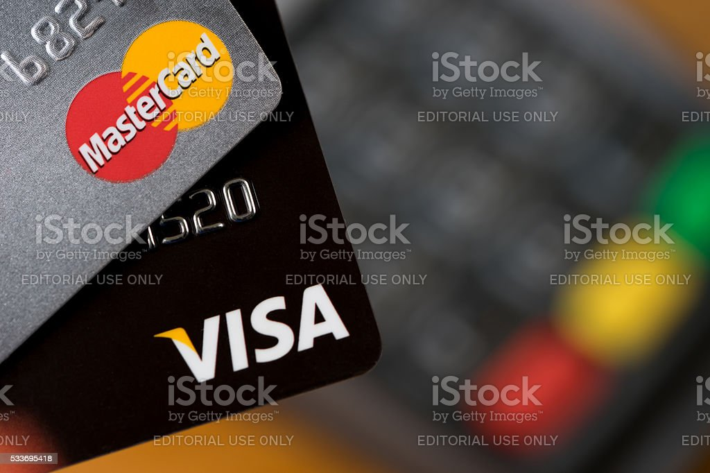 VISA and MASTER card on the credit card machine. stock photo