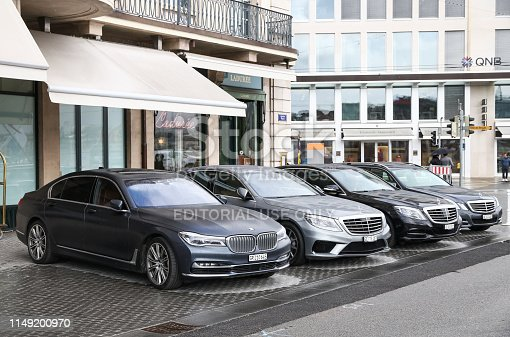 Geneva, Switzerland - March 13, 2019: Luxury saloon cars BMW and Mercedes-Benz in the city street.