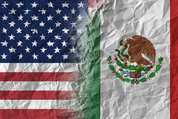 US and Mexico on crumpled paper, policy and relations concept stock photo