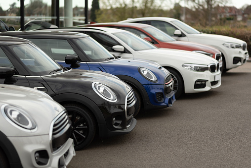 Stafford, England, UK - 05th April 2020: BMW and Mini Cooper cars for sale at dealership. BMW is a luxury German car brand.
