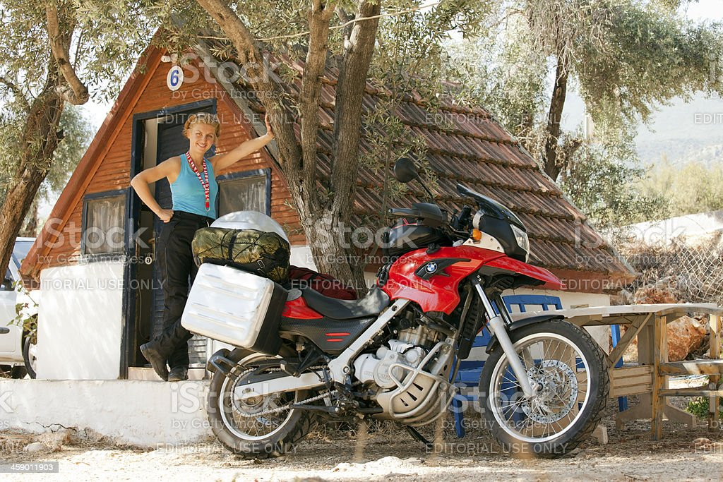 BMW F650 GS and Motorcyclist Woman in Camping Area stock photo