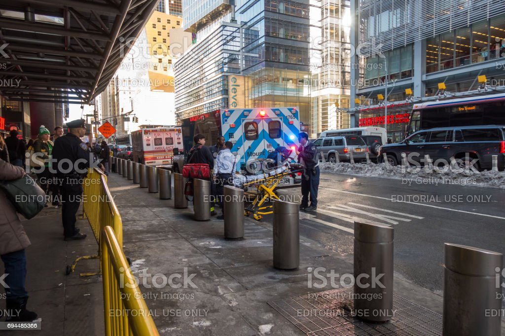 FDNY and Mount Sinai Ambulance flashing lights siren blasting with first ait kit and stretcher in Manhattan. stock photo