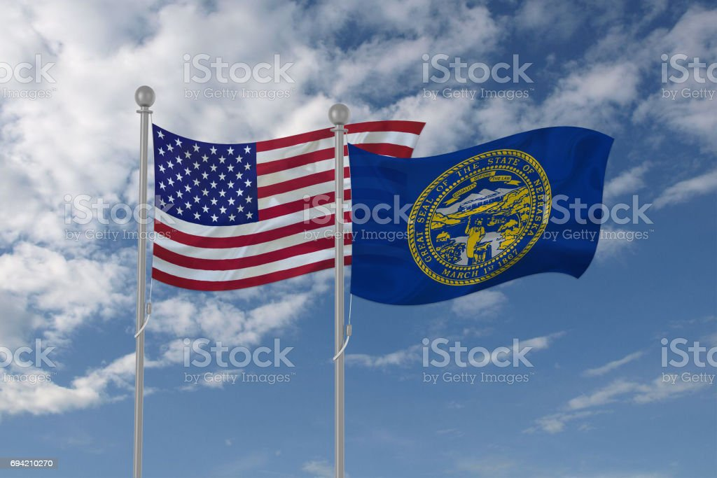 USA and Nebraska flag waving in the sky stock photo