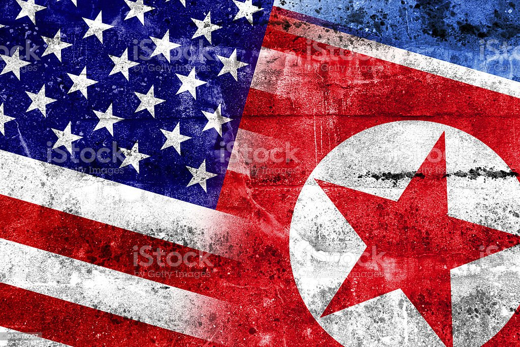 USA and North Korea Flag painted on grunge wall stock photo