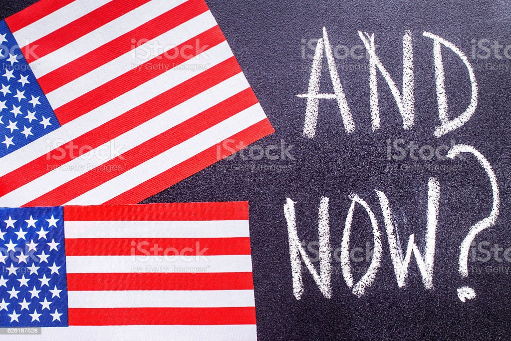 And Now  on the chalk board and US flag stock photo