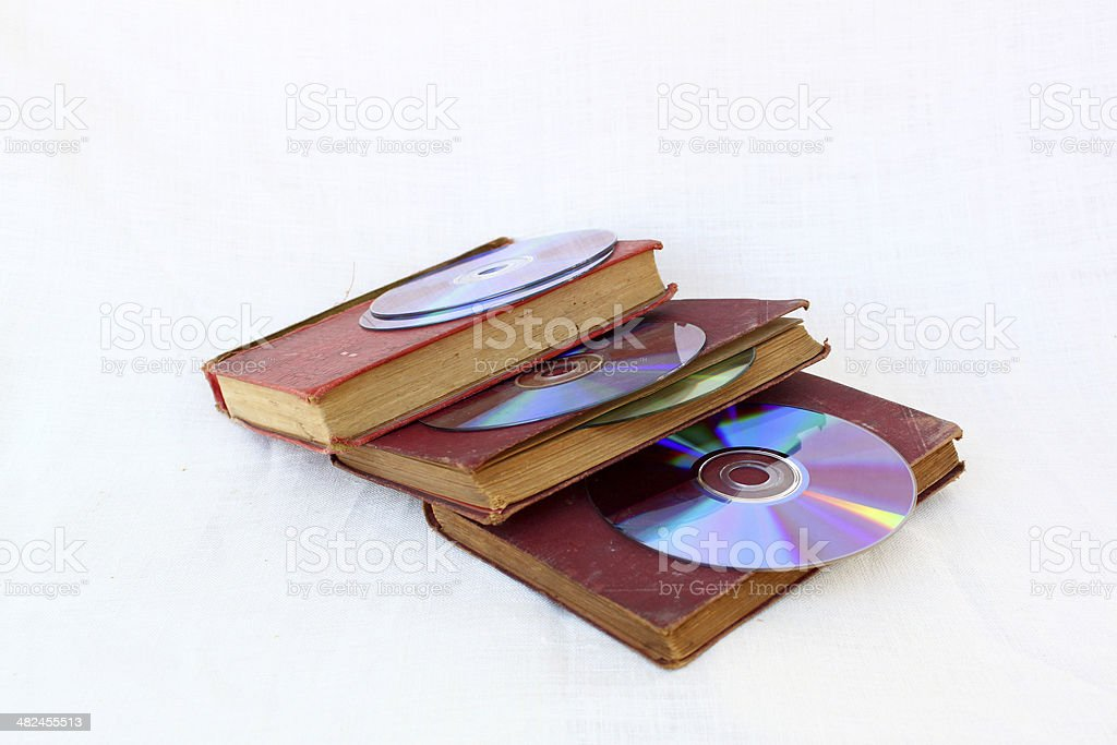 CD and old books stock photo