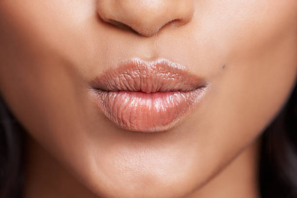 And one for you Cropped shot of a woman's beautiful lips puckering stock pictures, royalty-free photos & images