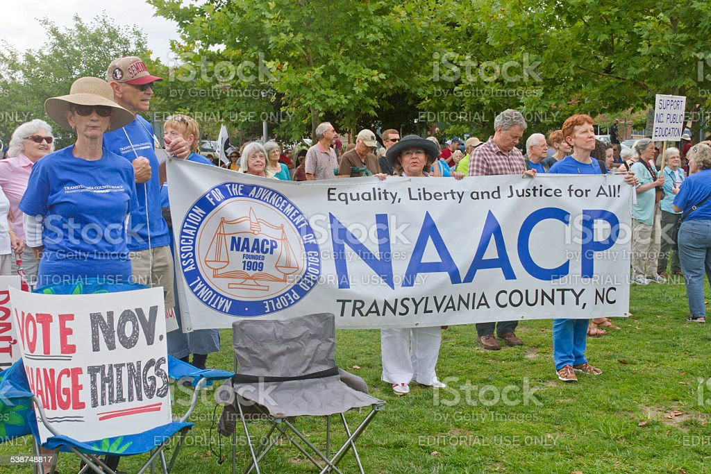 NAACP and Other Moral Monday Signs stock photo