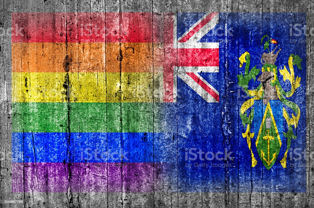 LGBT and Pitcairn Islands flag on concrete wall stock photo