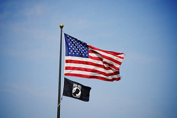 US and POW Flags stock photo