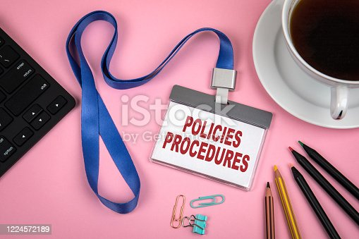 464906632 istock photo POLICIES and PROCEDURES concept. Staff Identity, cup of coffee and black computer keyboard 1224572189