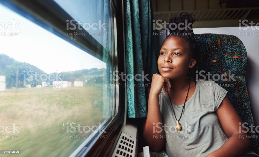 And she asks herself where to next? Cropped shot of a young attractive woman traveling by train 20-29 Years Stock Photo
